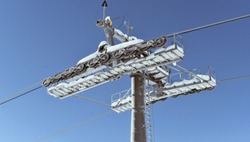chairlift and blue sky. snow. winter.