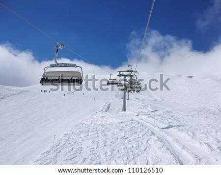 Chairlift and mountain with nice blue sky in Alps