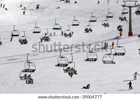 Chairlift at crowded spanish ski resort