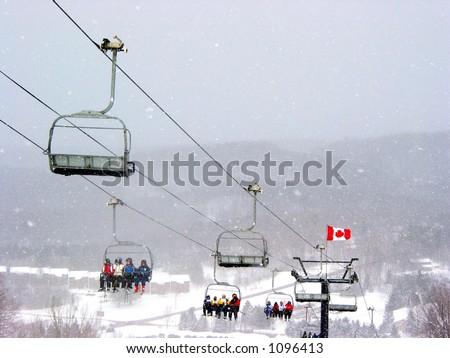 Chairlift at Horseshoe ski resort during heavy snowfall