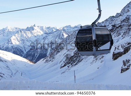 chairlift in beautiful winter snowy alpine mountains