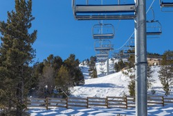 Chairlift line at a winter resort in the mountains.
