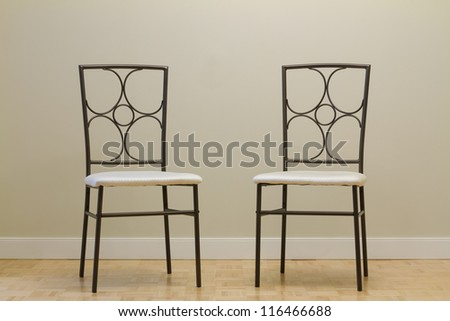 Chairs against wall in a new apartment