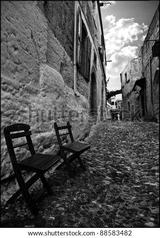 Chairs along an ancient road