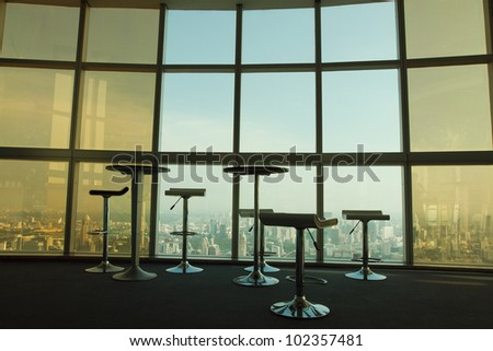 chairs and tables - abstract interior of place for meeting - stock photo