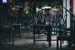 Chairs and tables stacked in a closed pub