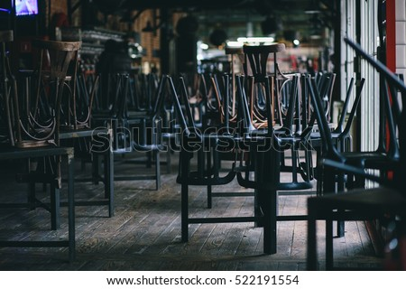 Chairs and tables stacked in a closed pub #522191554