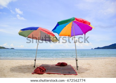 Chairs and umbrella in  beach - tropical holiday. #672562774