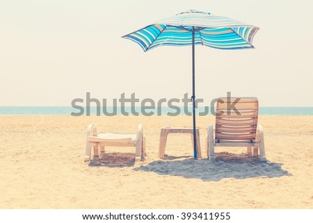 chairs and umbrella on tropical ...
