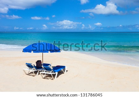 Chairs and umbrellas on a beautiful Caribbean beach #131786045