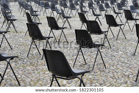 Chairs arranged widely from each  in the city center of Locarno in Switzerland for an open air event. It complies with rules for social distancing and awareness against coronavirus and covid-19. Stock photo ©