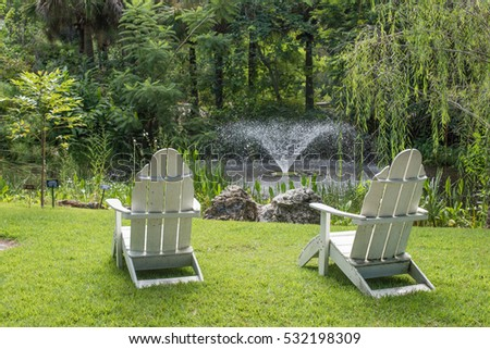 Chairs in front of pond