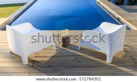 Chairs in modern house with wooden deck #572784301