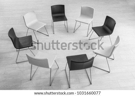 Chairs in room prepared for group psychotherapy session #1031660077