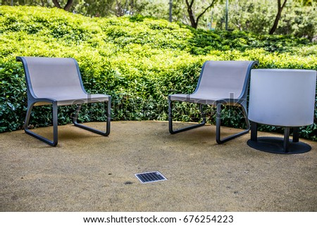 Chairs in the park with a lamp #676254223