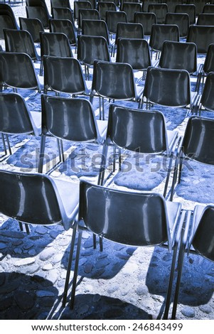 Chairs of an outdoor cinema - toned image
