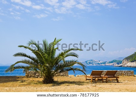 Chairs on beach at Dubrovnik, Croatia - vacations background