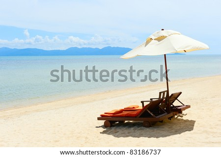 Chairs on beach near the sea - stock photo