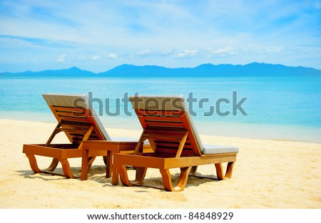 Chairs on the beach near sea