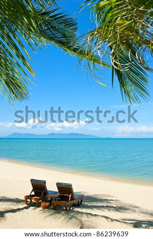 Chairs on the beautiful sandy beach near sea