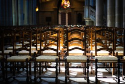 Chairs or benches in the church expresses loneliness and anticipation.