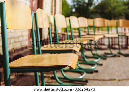 Chairs outdoor - toned image. Public outdoor event