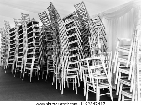 Chairs stacked in a marquee Black & White #1199347417