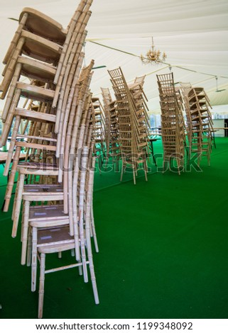 Chairs stacked in marquee #1199348092