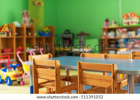 Chairs, table and toys. Interior of kindergarten. Stock foto ©