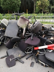chairs that have been used and damaged and stored in a special place for disposal