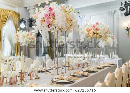 Chairs with round backs stand at dinner table with orchids
