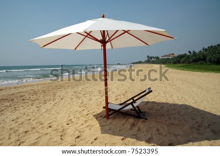 chaise longue and umbrella at the beach