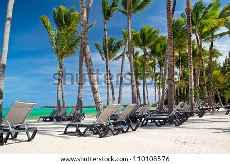 Chaise-longues on caribbean sea beach, Dominican Republic
