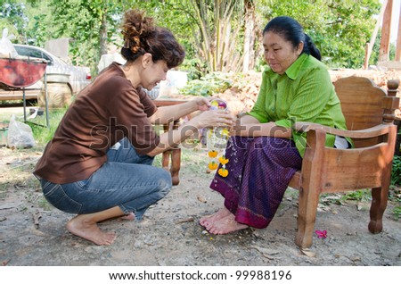 CHAIYAPHUM, THAILAND - APRIL 13: Thai people celebrate Songkran (new year / water festival: 13 April) by giving garlands to their seniors and asked for blessings on April 13, 2012 in Chaiyaphum, Thailand.