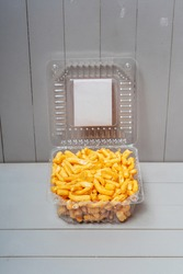 Chak-chak national Tatar cookies in plastic transparent boxes on a white background. Homemade Bashkir cookies. Chuck chuck sweet pastries for tea