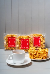 Chak-chak national Tatar cookies in plastic transparent boxes with a cup of black red tea. Homemade Bashkir cookies. Chuck chuck sweet pastries for tea