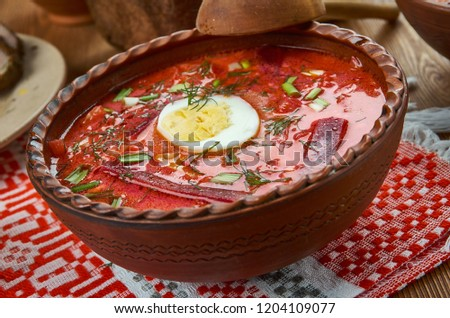 Chaladnik ,cold borscht made of beets, beet leaves or sorrel and served with sour cream, Belarusian  cuisine, Traditional assorted dishes, Top view.