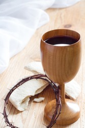 Chalice of wine, passover bread, thorns as Jesus Last Supper and Passion of Christ concept