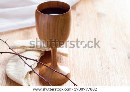 Chalice of wine, passover bread, thorns as Jesus Last Supper and Passion of Christ concept Stock photo ©