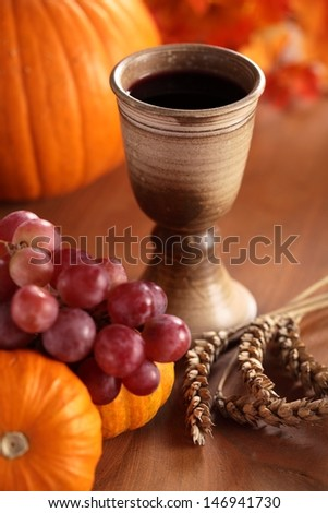 Chalice with wine, grapes, corn and pumpkins - thanksgiving or autumn still life