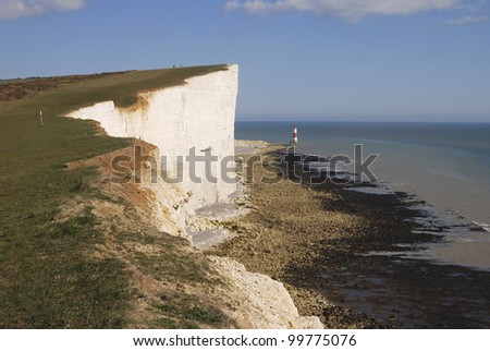 Chalk cliffs at Beachy Head near Eastbourne. East Sussex. England. With lighthouse under cliff on beach