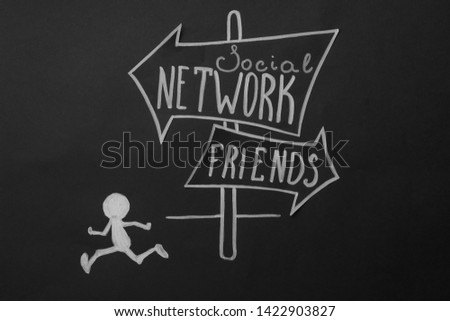 Chalk drawing of human figure near sign with words SOCIAL NETWORK and FRIENDS on black background, top view. Loneliness concept #1422903827