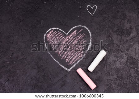 Chalk drawing of pink heart on the blackboard. #1006600345