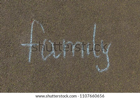 chalk inscription, family inscription on the pavement in large letters #1107660656