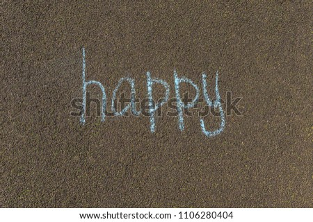 chalk inscription, happy, the inscription on the pavement in large letters #1106280404