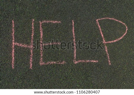 chalk inscription, help, the inscription on the asphalt in large letters #1106280407