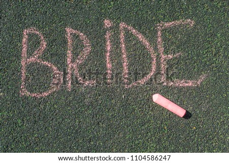 chalk inscription, the bride, the inscription on the pavement in large letters #1104586247