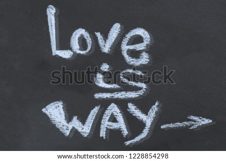 chalk message love is way on a dark background arrow basis design basis craft