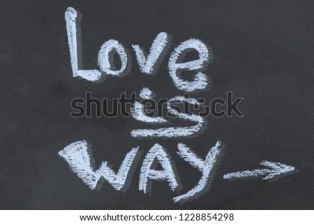 chalk message love is way on a dark background arrow basis design basis craft