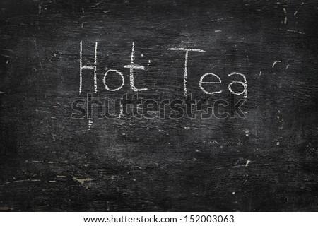 Chalk on black board: Hot Tea